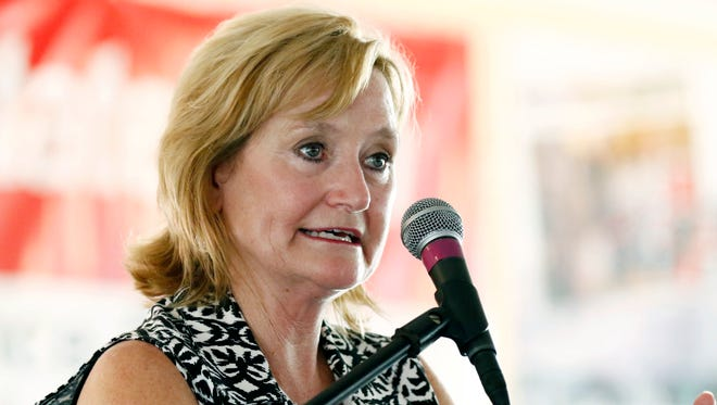 In this July 27, 2017, file photo Mississippi Commissioner of Agriculture and Commerce Cindy Hyde-Smith speaks at the Neshoba County Fair in Philadelphia, Miss.