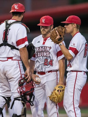 """Eric Carter (24) talks to his in field after just giving up a run scoring double in a 6-3 loss to Louisiana Tech  on Wednesday night at M.L. """"Tigue"""" Moore Field."""
