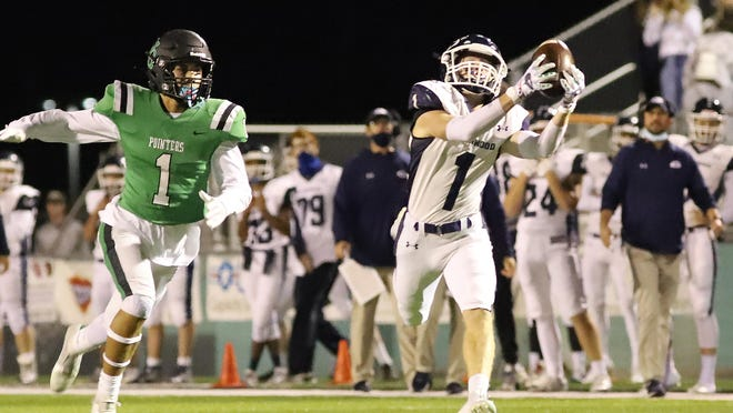 Greenwood's Caden Brown makes the catch over Van Buren's Chi Henry, Friday, Oct. 30, in the first half. Greenwood won the game 50-29.