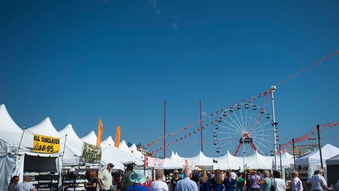 Visitors bustle about the Ocean City inlet as Sunfest kicks off Thursday, September 18.