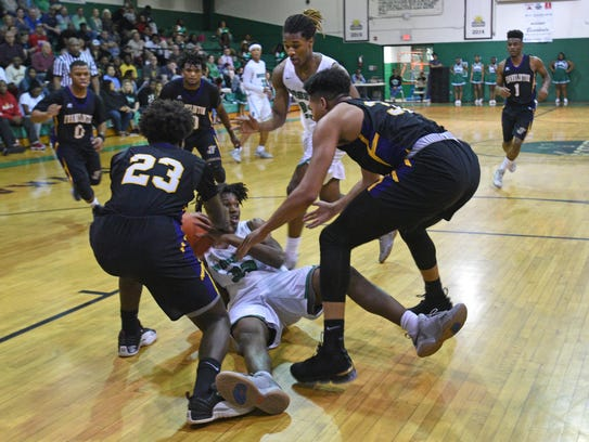 Bossier's Michael Green fights for a loose ball against