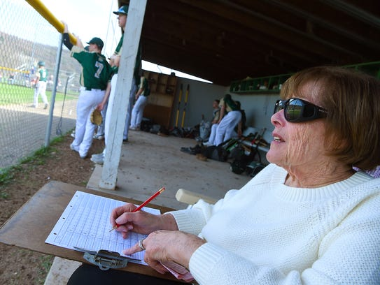 Lenore Redolphy, 83, keeps score for Vestal's baseball team May 1, 2018. The Endicott resident has been scorekeeper for Vestal High athletic teams since the 1980s.