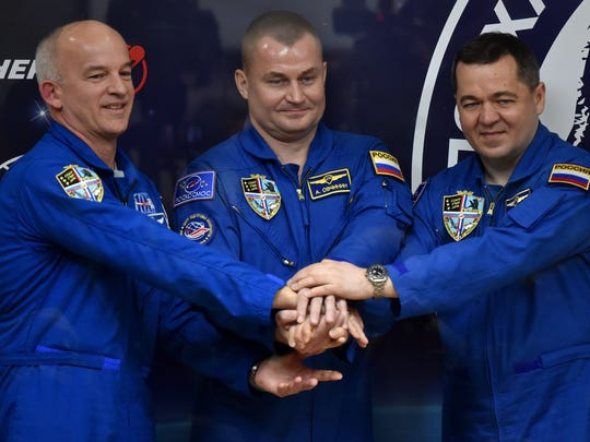 Members of the crew to the International Space Station: