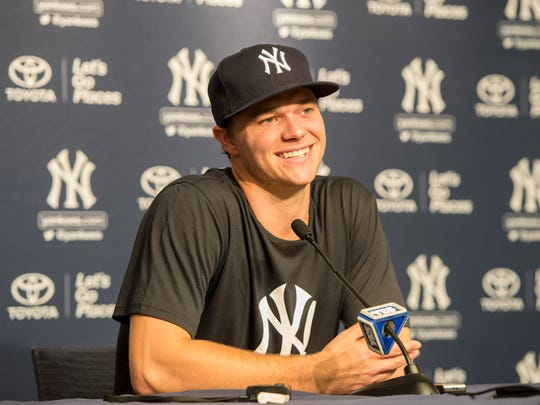 Yankees pitcher Sonny Gray (55) meets with the media