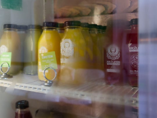 Prepared juices are stocked up daily in the refrigerator at Juicelation in Naples, Florida on Friday, June 15, 2018.