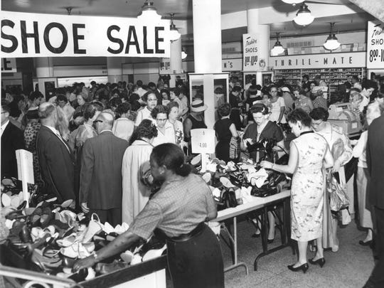 """Economy minded shoppers were jammed into the basement of the H.P. Wasson & Co Dept. store for a literal """"bargain basement"""" shoe sale during Hoosier Bargain Days in July, 1960."""