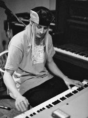 Kid Rock tinkering on the piano at White Room Studios in March 1995.