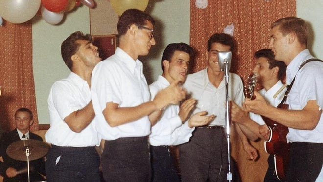 Ray and the Darchaes (from left: Ray Dahrouge, Sal Capolongo, Louie Scalpati, Tony Juliano, Dennis Testa and Sam Siciliano) rock the mike in this vintage photo.