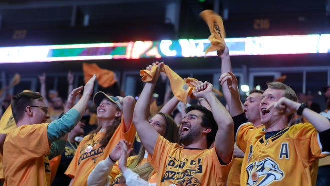 Fans celebrate as the Predators go up 3-0 in the third period during the watch party for game 6 of the playoff series between the Predators and Jets in Walk of Fame Park Monday May 7, 2018.