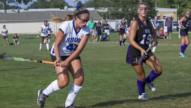 Shore's Anna Cooper (left) attempts to hit the ball as Rumson-Fair Haven's Emma Damelio closes in during a game on Sep. 8, 2016