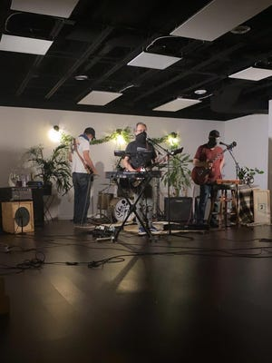 Akron rock band Stems records its set at Yoga Squared for CouchRokr 2020. Singer-guitarist Justin Seeker (center) gave the virtual version of PorchRokr its cheeky name.