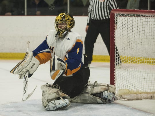 Milton goalie Eric Roy (1) makes a save during the boys hockey game between the U-32 Raiders and the Milton Yellowjackets at Cairns Arena on Jan. 3 in South Burlington.