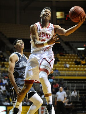 Alabama all-star Dazon Ingram (12) goes to the hoop against Mississippi during the Alabama-Mississippi Basketball All-Star Game at the Alabama State University Acadome in Montgomery, Ala., on Friday March 20, 2015.