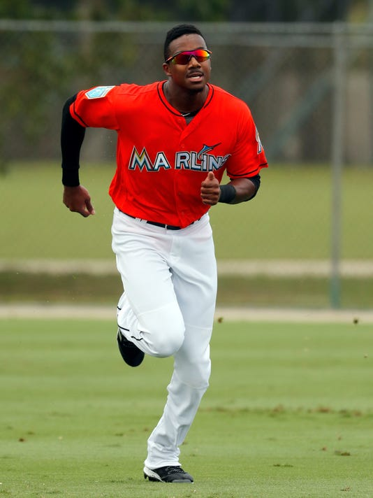 FILE - In this Feb. 19, 2018, file photo, Miami Marlins outfielder Lewis Brinson runs sprints during spring training baseball practice, in Jupiter, Fla. Lifelong Marlins fan Lewis Brinson is eager to see his team make the playoffs for the first time in 15 years, because he's expected to be their opening day center fielder. (AP Photo/Jeff Roberson, File)