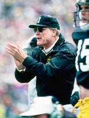 Iowa Hawkeyes head coach Hayden Fry on the sideline