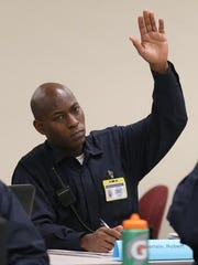 Robert Chamberlain raises his hand to answer a question during class at the Indianapolis Metropolitan Police Department training academy Friday, Jan. 9, 2015.