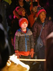 People view the living nativity Thursday during the