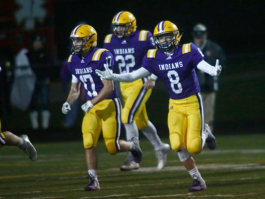 Indianola junior Grant Hixson (8) reacts after making