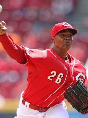 Cincinnati Reds starting pitcher Raisel Iglesias (26) throws against the St. Louis Cardinals during the first inning of a baseball game, Sunday, Sept. 13, 2015, in Cincinnati.
