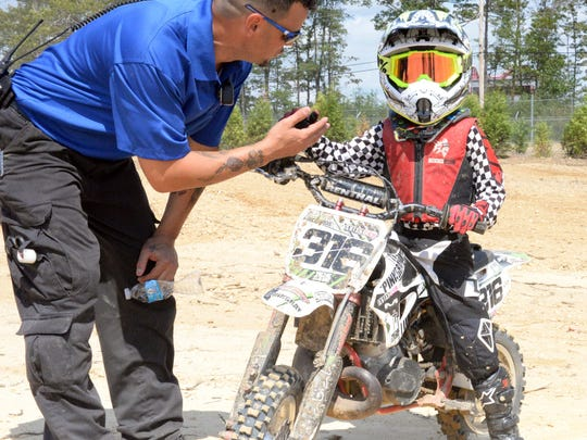 Canyon Richards, 6, of Egg Harbor Township, meets Noel Almodovar, a staff EMT at the Field of Dreams motocross track, in Millville on Friday.