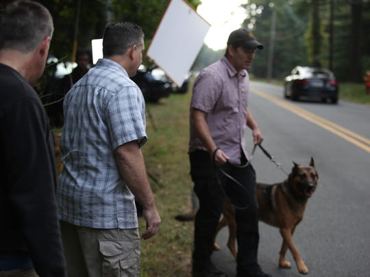 Security sweeps members of the media outside Vice President Joe Biden's Greenville home.