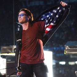 "Bono, lead singer of U2, displays American flag lining in his jacket after singing ""Where The Streets Have No Name"", during the halftime show of Super Bowl XXXVI in the Superdome, New Orleans, Feb. 3, 2002."