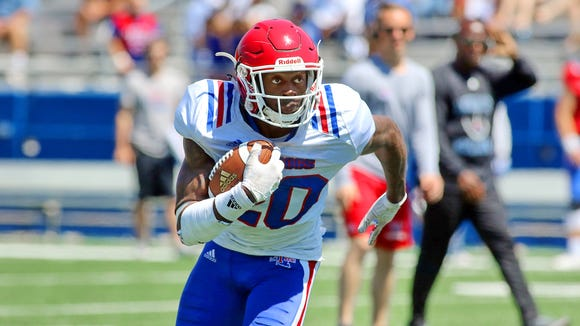 Louisiana Tech running back Jaqwis Dancy carries the ball in the Bulldogs' spring game. Dancy returned to the field following a several month battle with cancer.