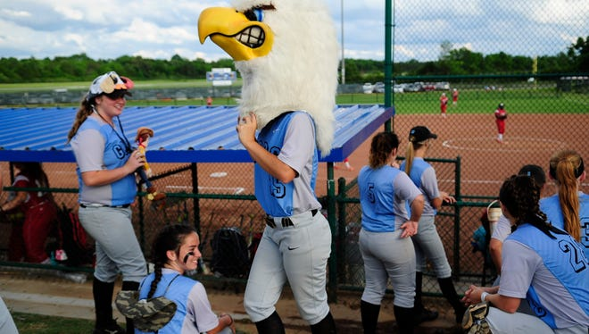 Gibbs' Jade Mullins (25) puts on an eagle mascot head during a Division 1 Class AAA softball game between Coffee County and Gibbs at the 2017 TSSAA Spring Fling state championships at the Murfreesboro Sports Complex & McKnight Fields in Murfreesboro, Tennessee on Tuesday, May 23, 2017.