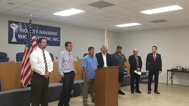 In a move aimed at sparking economic growth in the Navarre area, the Holley-Navarre Water System announced Wednesday temporary reductions in water and sewer fees for new businesses looking to locate along the U.S. 98 and State Road 87 corridors.