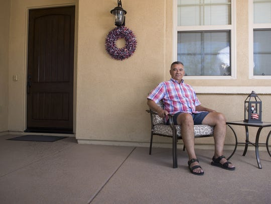 Tony Munro poses outside his house on Friday, June