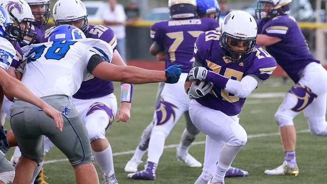 Kirtland Central senior running back Derek Curley breaks away from the pack against Snowflake, Ariz. on Friday at Bronco Stadium in Kirtland.