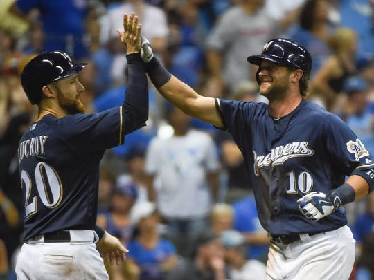 Milwaukee Brewers' Kirk Nieuwenhuis, right. is greeted by Jonathan Lucroy after hitting a three-run home run off Chicago Cubs pitcher Mike Montgomery during the eighth inning July 23 in Milwaukee. Milwaukee won 6-1.