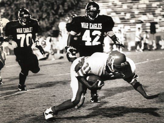 A Cooper player dives for a touchdown during the 1993 crosstown game against Abilene High.