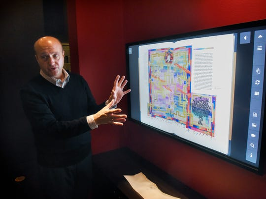 Hill Museum & Manuscript Library Director Tim Ternes talks about features of an interactive display in the Saint John's Bible Gallery on Thursday, Oct. 5, at the Alcuin Library on the campus of St. John's University.