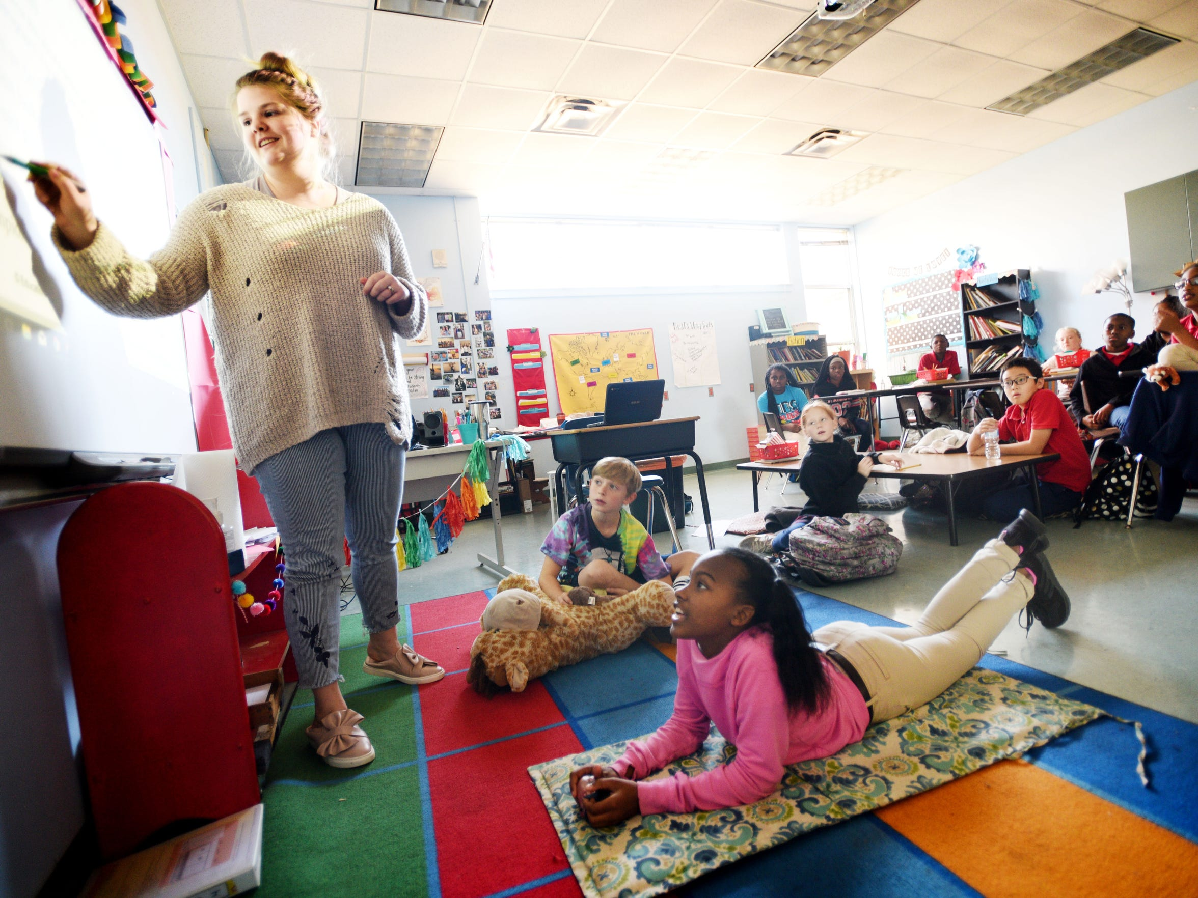 University Elementary student Kaley Jenkins listens to her teacher, Amber Neal, in a relaxed classroom Tuesday, December 4, 2018.