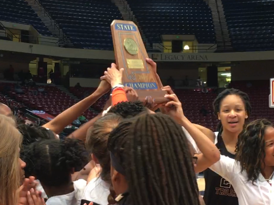 Maori Davenport and the Charles Henderson girls basketball team show off the 5A championship trophy last season.
