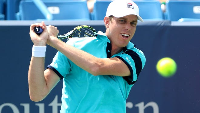 Sam Querrey returns a shot against John Isner on Tuesday during the first round of the Western and Southern Open at the Lindner Family Tennis Center in Mason.