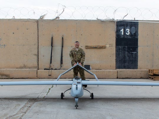 Sgt. 1st Class William Romanoff stands with a Shadow