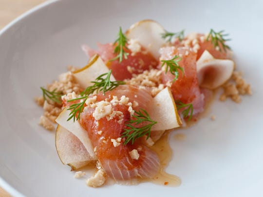 Albacore crudo with dill, yuzu ponzu, marcona almond, yuzu koshu and Asian pear at Cerulean.