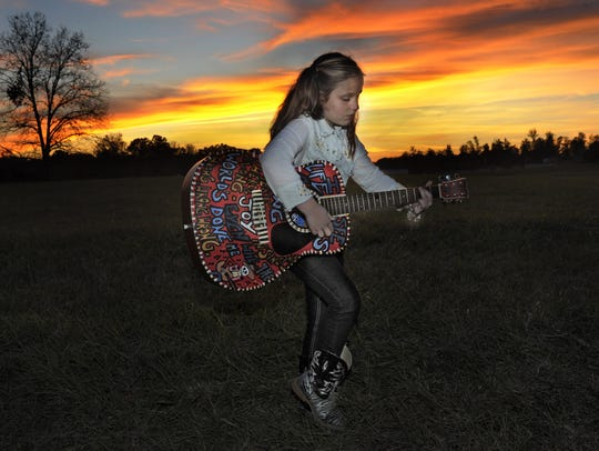 Emi Sunshine, shown in 2014 when she was 10, is playing