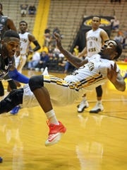 Jan 15, 2015; Hattiesburg, MS, USA; Southern Miss Golden Eagles guard Matt Bingaya (2) falls after making contact with Middle Tennessee Blue Raiders guard Marcus Tarrance (23) in the second half at Reed Green Coliseum. The Blue Raiders won 62-61. Mandatory Credit: Chuck Cook-USA TODAY Sports