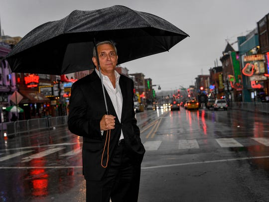 Butch Spyridon, President and CEO of the Nashville Convention & Visitors Corporation poses for a portrait at the over looking Broadway in Nashville, Tenn., Wednesday, Dec. 20, 2017.