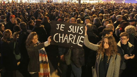 Thousands gather in Paris, among the many demonstrators worldwide expressing their solidarity with the French satirical weekly, Charlie Hebdo.