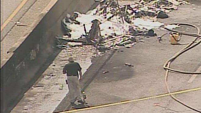 Officials investigate a plane crash on I-285 in Atlanta.