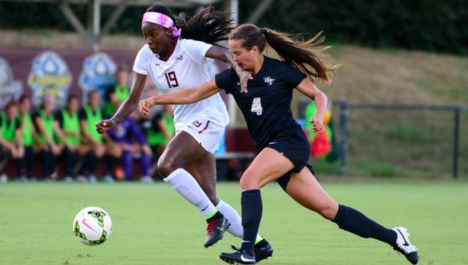 Cheyna Williams runs past a defender as FSU defeated UCF 4-0