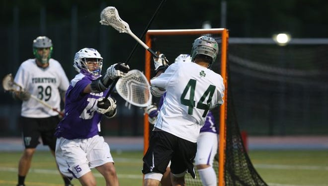 John Jay defender Braden Burke attempts to stop a shot during last spring's Section 1 Class B final against Yorktown.