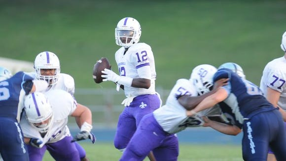 New Rochelle quarterback Greg Powell surveys the field during his team's 18-16 win at John Jay-East Fishkill on Sept. 4, 2015. The teams will have a rematch on Nov. 7 in the Section 1 Class AA championship game.