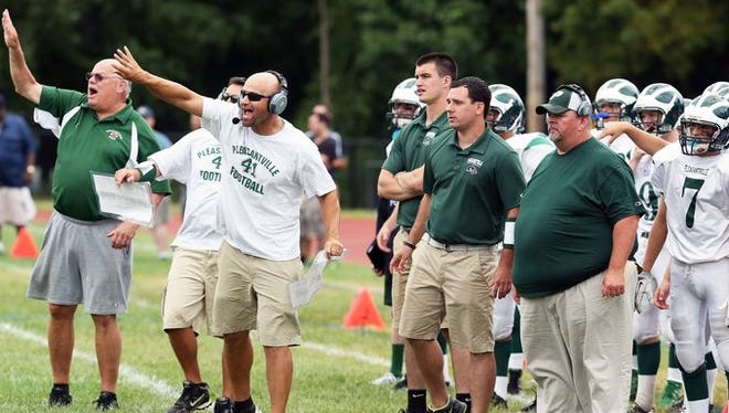 Pleasantville coach Tony Becerra (pictured in sunglasses) and his team. The Panthers beat Blind Brook 28-0 on Sept. 10, 2016.