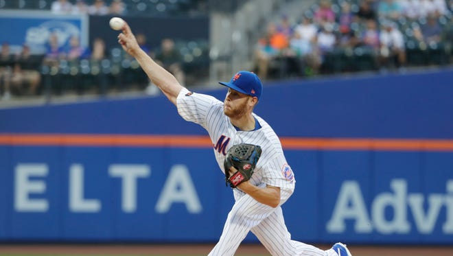 New York Mets' Zack Wheeler delivers a pitch during the first inning against the San Diego Padres in a baseball game Tuesday, July 24, 2018, in New York.
