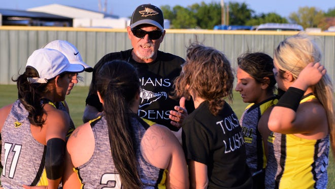 Haskell coach John Foster, who clinched his eighth district championship in 13 years last week, speaks with some of his players following Friday's title-clinching district win at Hawley.